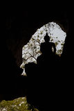 Cave window with silhouette of Buddha statue with backlight Royalty Free Stock Photo
