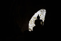 Cave Window With Silhouette Of Buddha Statue With Backlight Stock Photography