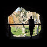 Cave in the zoo. A silhouette of a woman in the zoo cave Royalty Free Stock Photos