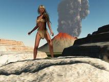 cavegirl火山 图库摄影