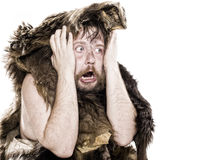 Caveman in bear skin Stock Photos