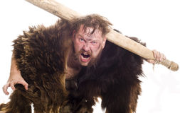 Caveman in bear skin Stock Photos