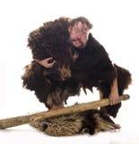 Caveman in bear skin stock images