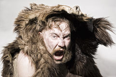 Caveman in bear skin Royalty Free Stock Image