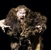 Caveman in bear skin. Isolated on white royalty free stock image