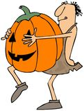 Caveman carrying a large pumpkin Royalty Free Stock Photo