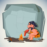 Caveman in cave with fire. blank space to fill your text. presen. Caveman in cave cooking meat food on fire. blank space to fill your text. presentation. stone Royalty Free Stock Photos
