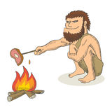 Caveman cooking meat on fire Stock Image