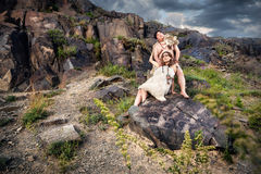 Caveman couple in animal skin Stock Photography