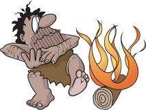 Caveman with fire. A cartoon caveman discovers fire. Layered vector and high resolution jpeg files available Royalty Free Stock Photos