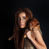 Caveman girl and red cat Royalty Free Stock Image