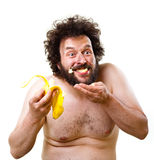 Caveman happy about having a banana to eat Royalty Free Stock Photo