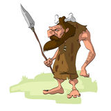Caveman hunter with a weapon Royalty Free Stock Photo