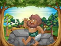 A caveman at the jungle Stock Image