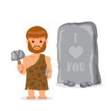 caveman Mâle près de l'inscription découpée dans la pierre Le concept de l'écriture préhistorique Image libre de droits
