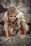 Caveman, manly boy hunting outdoors. Ancient warrior portrait. Caveman, manly boy hunting outdoors. Prehistoric tribal boy outdoors on nature. Young shaggy and stock photography