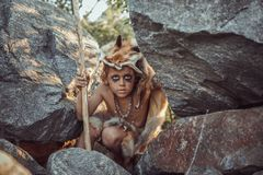 Caveman, manly boy hunting outdoors. Ancient warrior portrait. Caveman, manly boy hunting outdoors. Prehistoric tribal boy outdoors on nature. Young shaggy and royalty free stock images