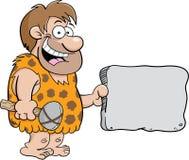 Caveman med ett tecken arkivbilder