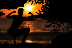 Caveman posture or action in the cave at red sky sunset. Background royalty free stock photography