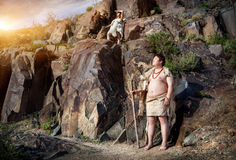 Caveman and woman in animal skin Royalty Free Stock Images