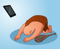 Caveman worshiping a gadget Stock Images