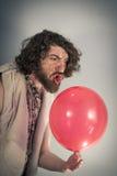 Caveman Yelling Balloon Stock Image