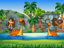 Cavemen and dinosaurs living together Royalty Free Stock Photo
