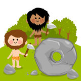 Cavemen inventing the wheel Royalty Free Stock Photos