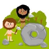 Cavemen inventing the wheel Royalty Free Stock Photos