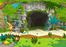 Cavemen near the cave - discovering places Royalty Free Stock Photography