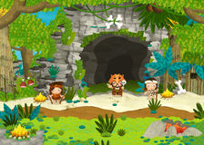 Cavemen near the cave - guards and shaman Royalty Free Stock Photography
