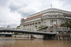 Cavenagh Bridge and The Fullerton Hotel in Singapore royalty free stock photography
