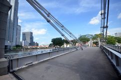 Cavenagh bro ovanför den Singapore floden, Singapore Arkivfoton