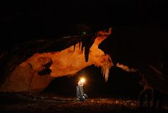 Caver. A girl in the cave royalty free stock photography