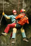 Caver abseiling in a pothole. Stock Photos