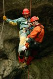 Caver abseiling in a pothole. A portrait of a young female caver exploring the cave royalty free stock photo