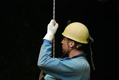 Caver abseiling in a pothole. Stock Images