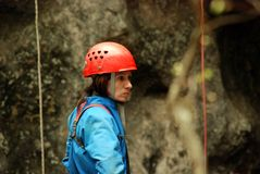 Caver abseiling in a pothole. A portrait of a young female caver exploring the cave stock photos
