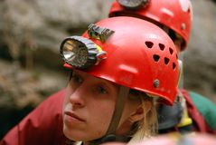 Caver abseiling in a pothole. A portrait of a young female caver exploring the cave royalty free stock image
