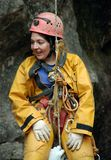 Caver abseiling in a pothole. A portrait of a young female caver exploring the cave stock photo