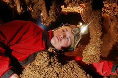 Caver admiring stalactites. In the cave stock photos