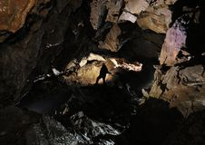 Caver in a cave Royalty Free Stock Image