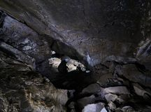 Caver in a cave Royalty Free Stock Photo