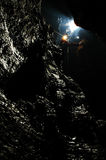 Caver descends in a cave Royalty Free Stock Photo