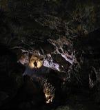 Caver en una cueva Imágenes de archivo libres de regalías