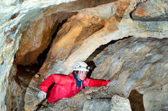 Caver exploring the cave Royalty Free Stock Image