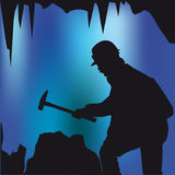 Caver with hammer Royalty Free Stock Images
