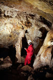 Caver logging survey data during cave mapping Royalty Free Stock Photography
