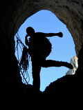 Caver silhouette. At the cave entrance royalty free stock images