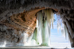 Cavern behind ice curtains on Grand Island on Lake Superior. Icicles drape from the ceiling like stalactites in a sea cavern in the Upper Peninsula of Michigan royalty free stock image